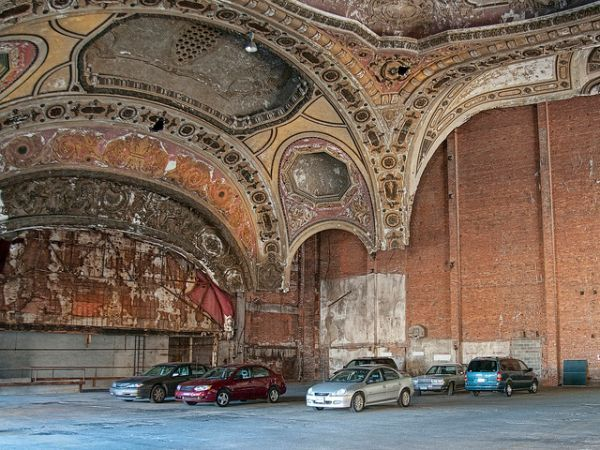 Former Renaissance-style theater built on the site of Henry Ford's first automobile workshop closed partly due to lack of parking in 1976, and then was turned into a parking structure itself.