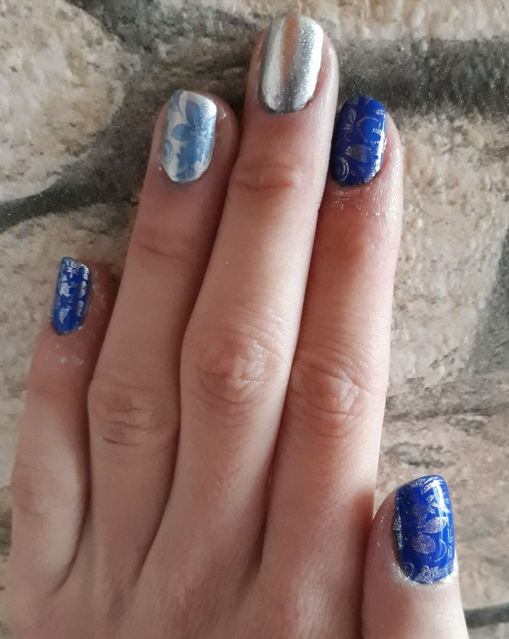 Winter nail art. Blue and silver colour.