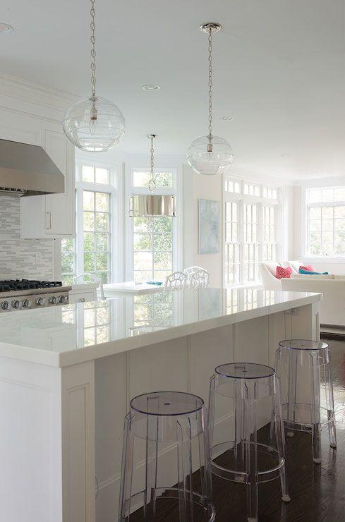 white cabinets + white/gray glass backsplash + white quartz counters clean island design