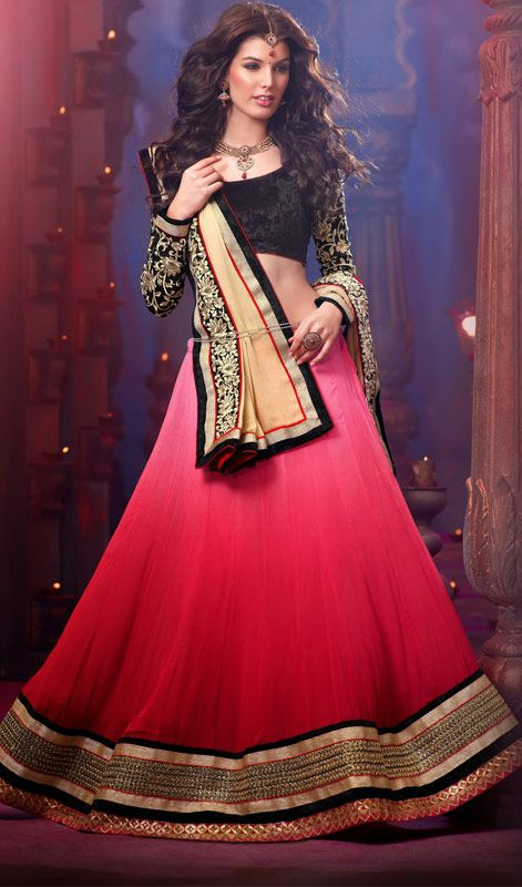 Traditional Georgette A Line Lehenga Choli Dictate popular styles in no time dressed in this traditional pink shaded faux georgette A line lehenga choli. Lehenga featuring cord work and crystal embellished decorative patterned bold hemline. Comes with a matching stitched round neck blouse with 6 inches sleeves. #TraditionalLehengaCholi #LongAnarkaliChuridarSuit