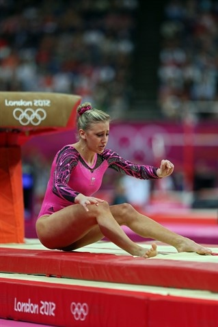 Ashleigh Brennan of Australia falls on her landing on the vault in the Artistic Gymnastics Women's Individual All-Around final