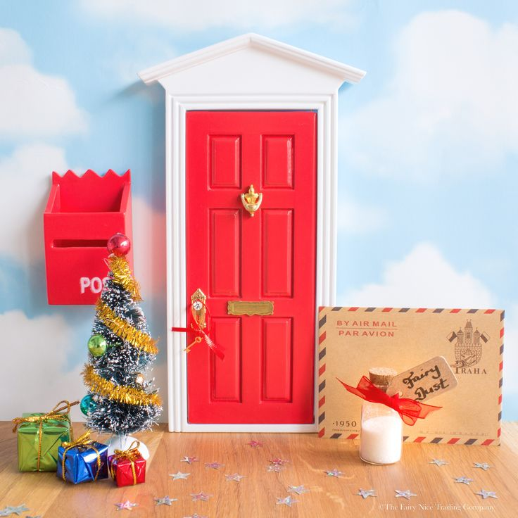 Exquisite Christmas Fairy Door set containing gorgeous large red Fairy Door, a personalised letter from the Fairies, and Christmas Fairy Door accessories.