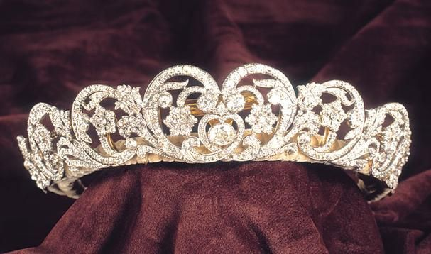 The Spencer Tiara. Best recognized as the tiara of Princess Diana, it consists of diamonds in silver settings mounted in gold in various floral shapes: stylized tulips, star-shaped flowers, and scrolling foliage.