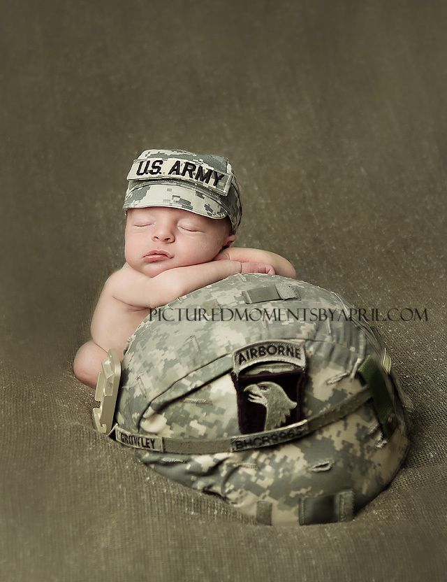 newborn boy with us army hat and dad's 101st airborne division helmet from fort campbell