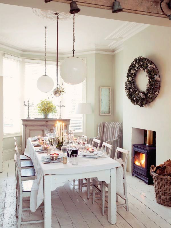 Love the soft calm colours of this dining room and the oversized wreath.