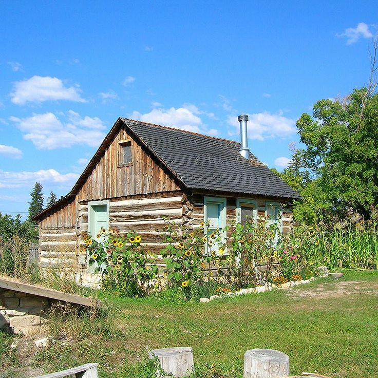 Pioneer log cabin in Spring City, UT, with stone root