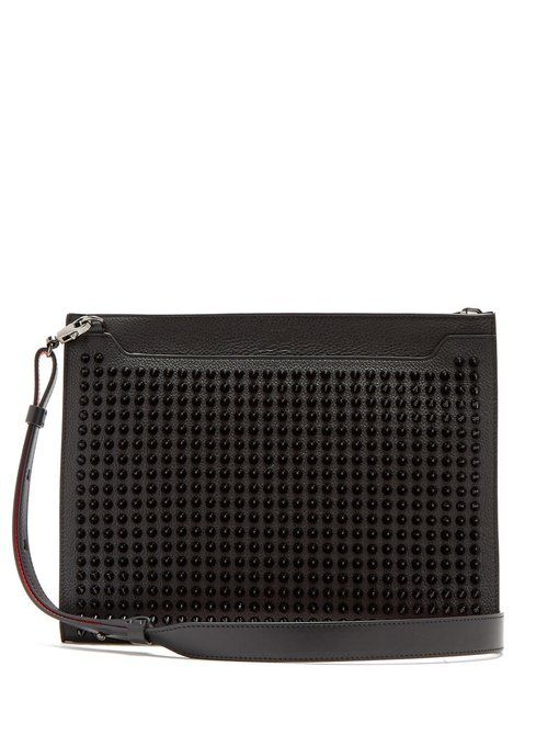 af56e810c8438 CHRISTIAN LOUBOUTIN Spike-embellished leather pouch.  christianlouboutin