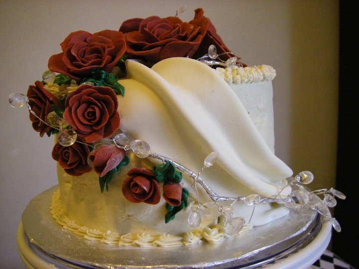 Butter cream base with fondant roses and drapery... Yeah I play baker sometimes ;p