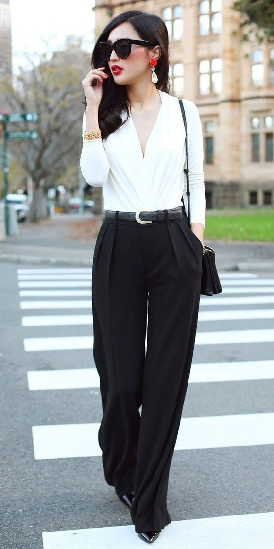 what to wear to work, outfit inspiration: wrap front white blouse, wide leg black pant, black leather belt, red lip, cat eye sunglasses, patent pumps, tear drop earrings, shoulder bag