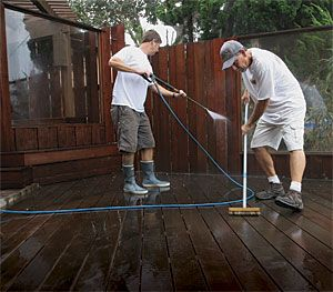Deck Refinishing... Rescuing a rust-stained  weather-beaten deck.