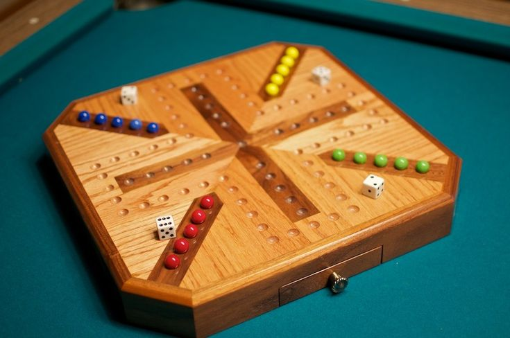 4 players, 5 marbles. As it should be.  Inlaid Wooden Oak and Walnut Aggravation Board. $130.00, via Etsy.