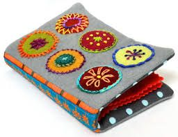 PENNY RUG..................PC  wool needle book                                                                                                                                                      More