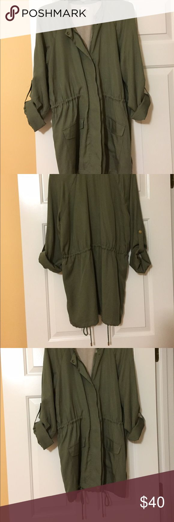 "Ultra soft Spring parka style jacket Never worn. This jacket is made from a silky fabric and is so soft. Olive green parka style. Size S. length from shoulder to bottom is approximately 30"". Also has detachable hood. Jackets & Coats Utility Jackets"