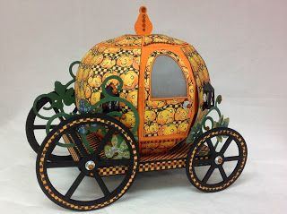 Tracey, with the help of some Graphic 45 paper, rises to the challenge in making this fantastic Halloween Carriage for a friend to use as a luncheon centerpiece!   The patterned paper is super cute giving this Carriage a mystical Halloween look!  Let your imagination take you on a magical ride!  Tracey's delightfully gorgeous Carriage is in ENCHANTED AUTUMN SVG KIT.