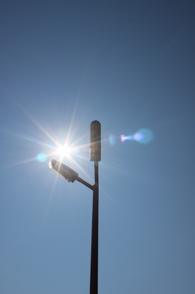 Sun Shining and Street Light Poles against Blue Sky - Public Domain Photos, Free Images for Commercial Use