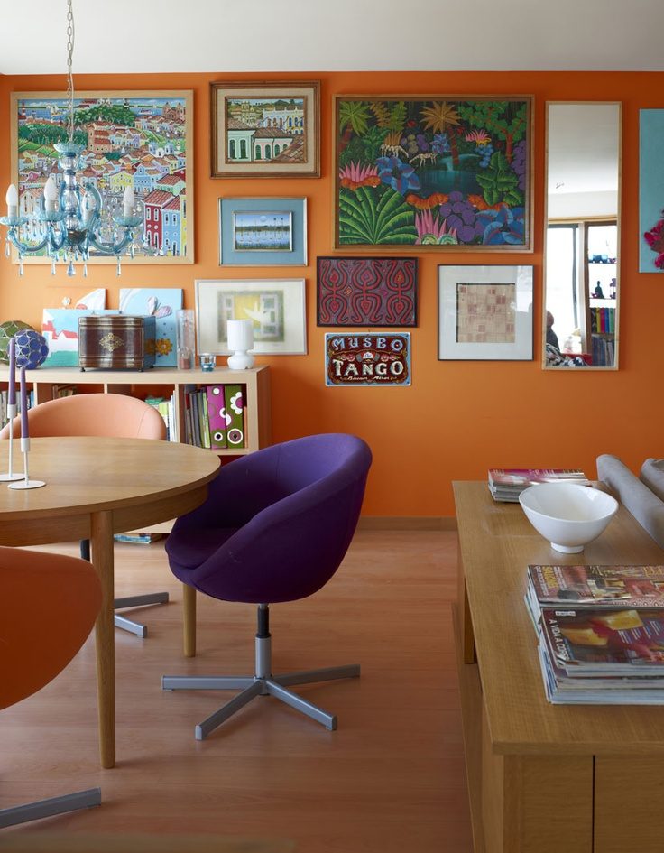 I love how the orange wall complements the colorful paintings. Also, I dig the chandelier! Colourful picture wall   live from IKEA FAMILY