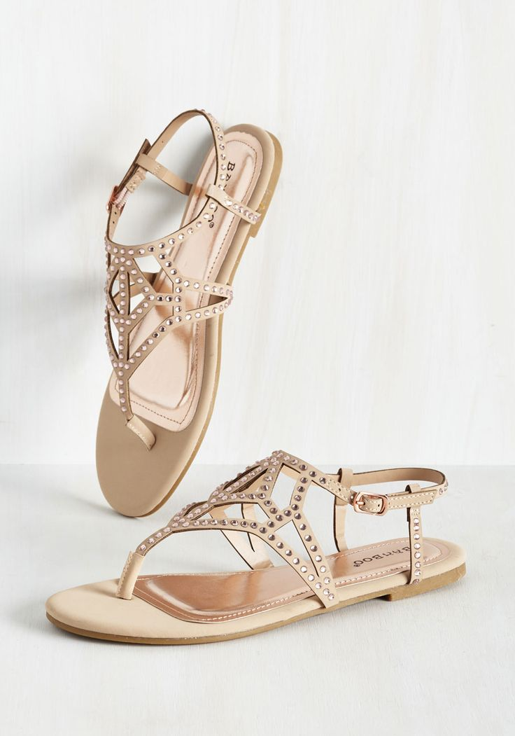 Why settle for sauntering when you can truly shine in these sparkly ecru sandals? Your strut will reach the next level of loveliness with every step you take in the plentiful cutouts and rose gold rhinestones that detail these pretty flats - as will your attitude!