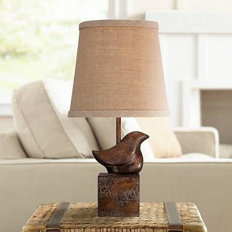 Add a sculptural element to your decor with this small accent table lamp, which features a delightful bird profile base.