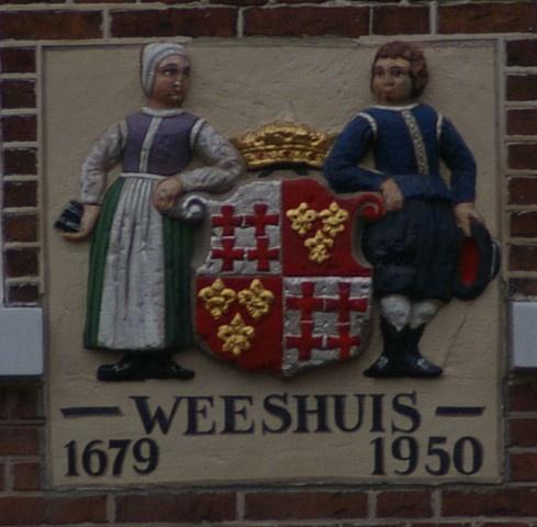Oude gevelsteen Weeshuis 1679