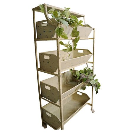 Perfect for growing climbing plants in the sunroom or stowing towels and linens in the guest suite, this charming 4-bin etagere adds essential storage space ...