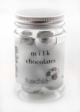 Fuschia candy jars, filled with milk chocolate balls in silver foil wrappers.  Look great on your tables and your guests will enjoy these yummy chocolates.  Perfect for wedding and party favours or small token gifts or party bag fillers.  £2.99 each from the Fuschia Boutique at www.fuschiadesigns.co.uk.