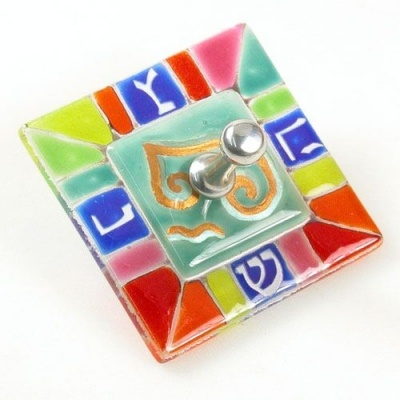 """Rainbow Colors Of Glass Fused Together Create This Fantastic Hanukkah Dreidel. With A Pewter Spinner And Gold Accents This Is A Must Have! The Hanukkah Dreidel Is 2 1/4""""."""