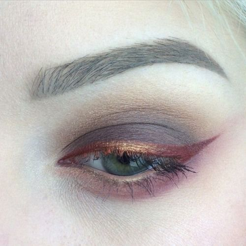 Red and gold wing liner with brown eyeshadow
