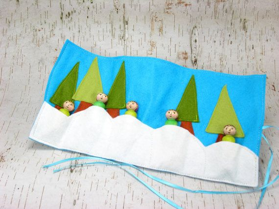 Our Winter Elves Roll Up and Play Mat is perfect for taking Winter Magic wherever you go! There are five snowy pockets for the elves to hide in as