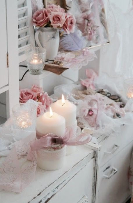 Shabby chic pink flowers and white candles                                                                                                                                                     More