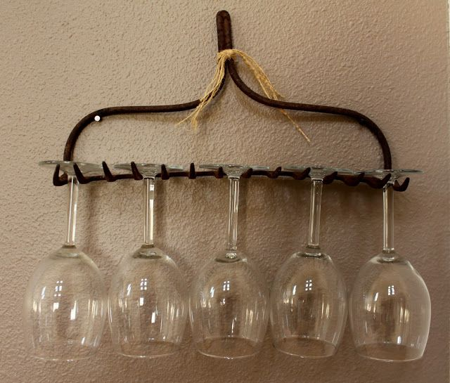 Mary Jane would love this idea!  Use a rake as a wine-glass holder.