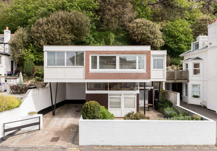A 1960s Timber Clad House on Stilts on The Kent Coast • Selectism