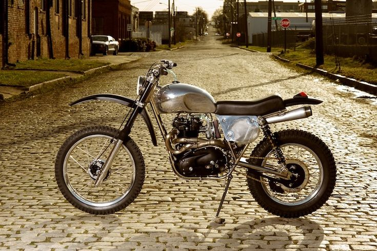 This bike was built by Clay Rathburn over at Atom Bomb Motorcycles, the garage is...custom vintage British motorcycles....Triumph and BSA relics....
