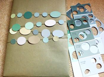 Paint Chip Gift Wrap Decoration. Make some beautiful and inexpensive gift wrap using the plain side of an old brown paper bag and paint chip samples. Denise at d.Sharp Journal posted about this: you just need a couple round hole punches in different sizes. The colors – all shades of the same hue – will harmonize nicely, because they're all from the same paint chip card.