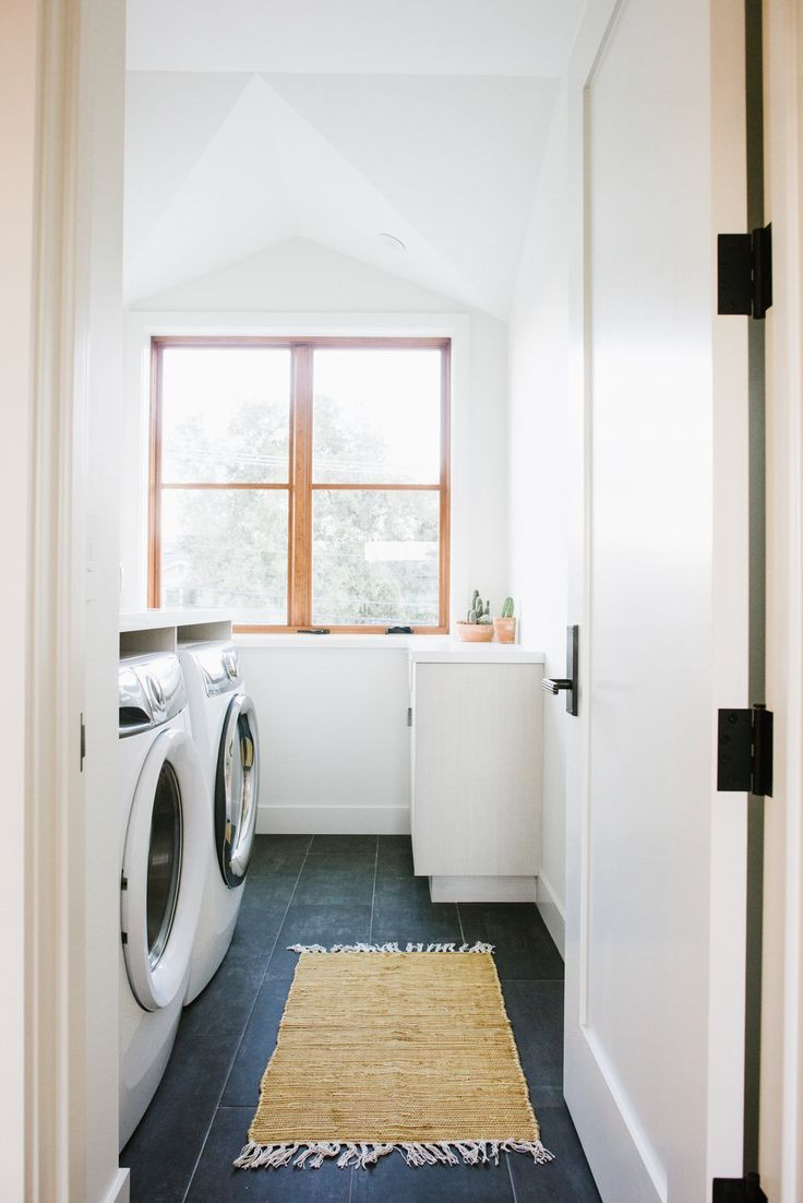 Small Cute White Laundry Room With Dark Floor Tile And Natural Rug Megan Bachmann White Laundry Rooms Laundry Design Laundry Room Design