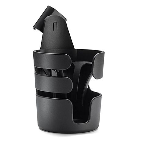 The Bugaboo Cup Holder attaches to the handle of your Bugaboo baby stroller, and stays level when holding your drink to prevent spills while strolling on inclined surfaces, making it perfect for holding sippy cups, bottles, or your own drink.