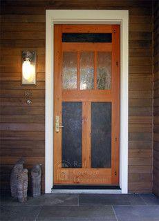 """Beautiful, eclectic front door by Real Carriage Door Co.  Called the """"Lone Wolf Front Door."""""""