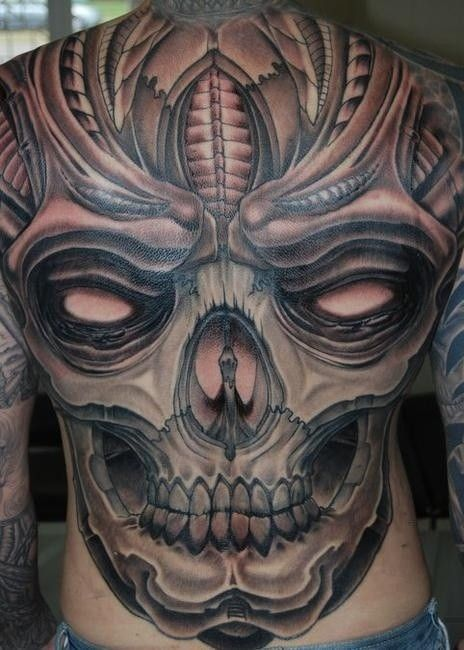 Spooky great skull tattoo on whole back