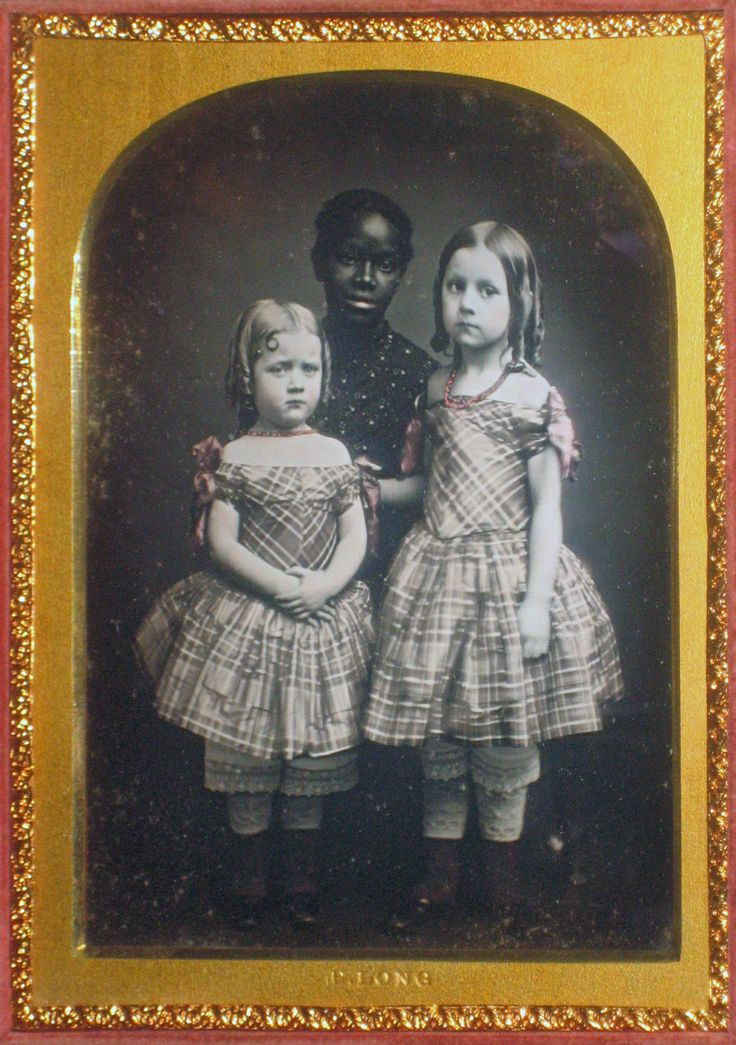 (c.1840s-50s) Very young Black Nanny with White Girls. Neither of the little girls appear to be too happy with the photography