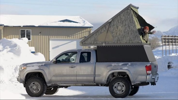 Truck canopy with sleep top by Go Fast Camper.