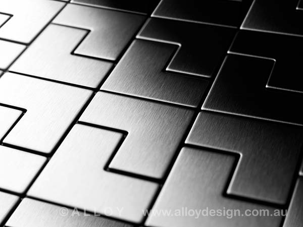 Karim Rashid for ALLOY 'Kink' tile in brushed stainless steel.