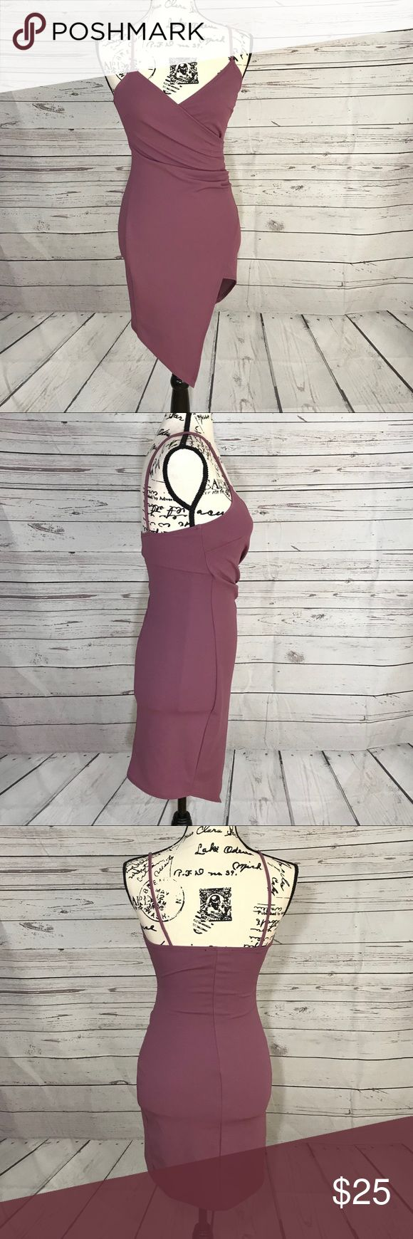 NWOT Love Culture Wrap Style Asymmetrical Bodycon Love culture asymmetrical wrap style mini dress. Super short on the short side of the skirt. Plunging v-neck. This dress is super sexy and perfect for all semi formal occasions or date nights. In a light plum color this is a stunner. Form fitting with some stretch. Brand new and never worn. Measurements coming soon. Love Culture Dresses Asymmetrical