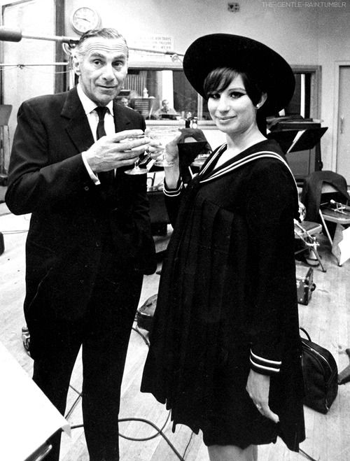 A pregnant Barbra Streisand and Goddard Lieberson (president of Columbia Records) photographed after a recording session in 1966.