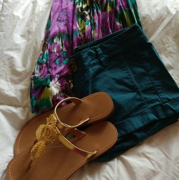 NWOT Teal Shorts Gorgeous teal shorts from Express. These are super comfortable - soft fabric with shape  Perfect condition...and POCKETS!  STYLE IT: These bright shorts can be dressed up or down, and the bright color will make any outfit POP! Top also available! Express Shorts