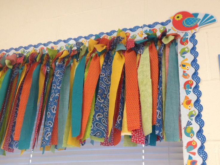 Classroom Window Valance made out of strips of quilting fabric tied to a tension rod. I matched the fabric to the bulletin board boarder I bought for this school year.