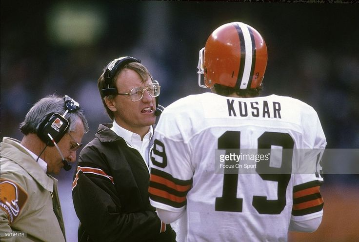 Head Coach <a gi-track='captionPersonalityLinkClicked' href=/galleries/search?phrase=Marty+Schottenheimer&family=editorial&specificpeople=184515 ng-click='$event.stopPropagation()'>Marty Schottenheimer</a> of the Cleveland Browns talks with his quarterback <a gi-track='captionPersonalityLinkClicked' href=/galleries/search?phrase=Bernie+Kosar&family=editorial&specificpeople=673013 ng-click='$event.stopPropagation()'>Bernie Kosar</a> #19 on the sidelines during a mid circa 1980's NFL football…