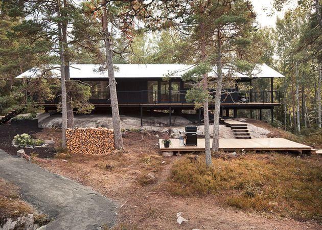 single-storey-summer-house-overlooks-forested-gorge-sweden-3-garden-deck.jpg