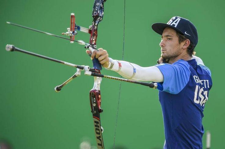 Unites States archer Zach Garrett of Wellington, Mo., shoots an arrow during men's team archery competition inside the Sambodromo…