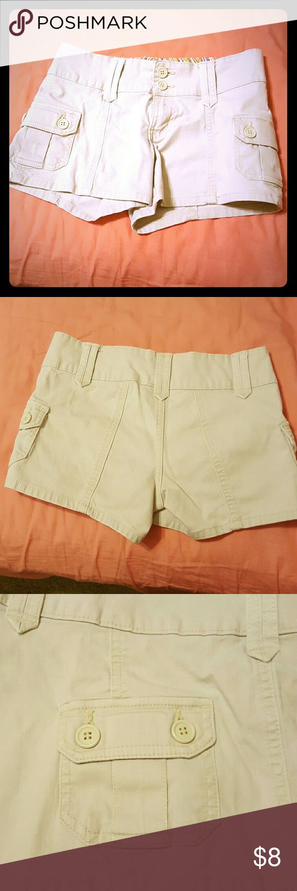 Khaki/Beige Shorts Approximately 10 inches long. Double button shorts with two side pockets. Sorry, no pockets on the backside. Get ready for spring & summer with this fashion staple! All my clothes come from a smoke free home. No stains or snags. Bundle for extra savings! Shorts