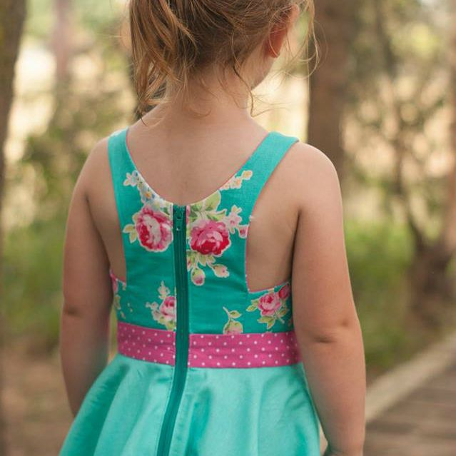 The Holly dress features a fitted, fully lined bodice, exposed zipper and the option of either a gathered skirt or a circle skirt.  Sewing level: Advanced beginner to intermediate  Sizes: 1 (18m), 2, 3, 4, 5, 6, 7, 8, 9, 10  This listing is for a PDF sewing pattern and is not for any finished dress pictured. The pattern includes:   Fabric and notion requirements  Full tutorial with easy to follow, step by step photos  Easy instructions for altering your pattern to fit  Layered…