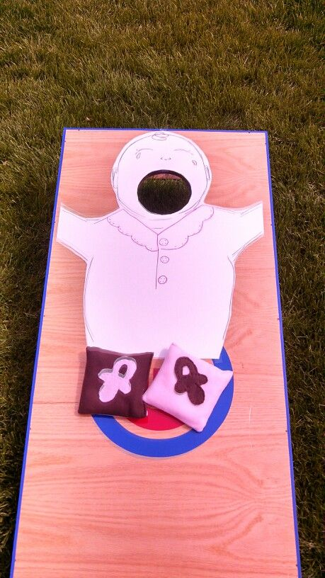 Baby bag toss. Toss the pacifier into the crying baby's mouth. Great for couples BBQ baby shower.